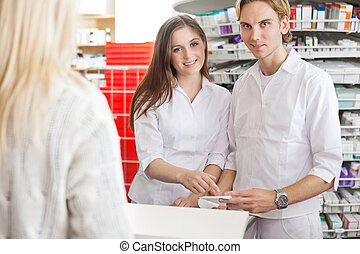 Pharmacists with Customer at the Counter