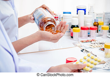 pharmacists working in office - two pharmacists holding...