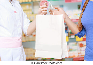 Pharmacy chemist and customer at the drugstore - Purchase in...