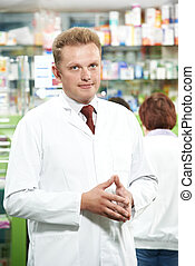 Pharmacy chemist man in drugstore