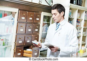 Pharmacy chemist man in drugstore - young pharmacist chemist...