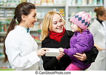 Pharmacy chemist, mother and child in drugstore - Cheerful ...
