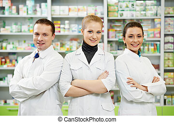 Pharmacy chemist team women and man in drugstore - cheerful ...