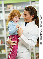 Pharmacy chemist with child in drugstore
