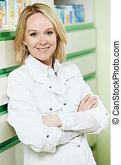 Pharmacy chemist woman in drugstore