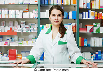 Pharmacy chemist woman in drugstore - cheerful pharmacist ...