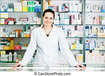 Pharmacy chemist woman in drugstore - Happy cheerful ...