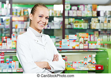 Pharmacy chemist woman in drugstore - positive pharmacist ...