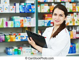 Pharmacy chemist woman in drugstore - positive pharmacist...