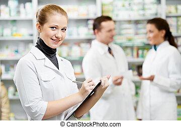 Pharmacy chemist women in drugstore - Female happy...