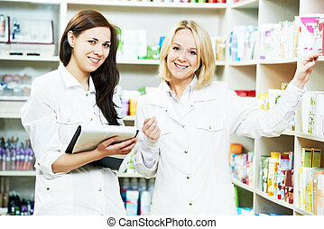 Pharmacy chemist women in drugstore
