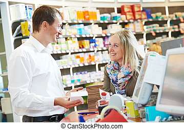 pharmacy chemist workers in drugstore - cheerful pharmacist ...