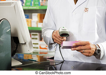 pharmacy - cropped view of pharmacist scanning medicine with...