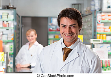 pharmacy - portrait of male pharmacist looking at camera and...