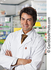 pharmacy - portrait of mid adult pharmacist looking at ...