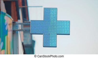 Pharmacy Sign cross medicine in a urban City. medical cross...