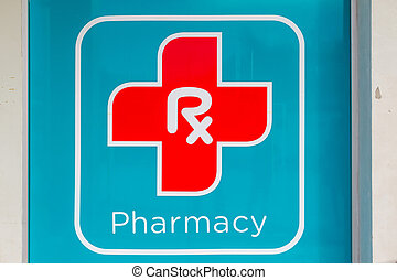 Pharmacy Sign - A pharmacy sign outside of a drug store.