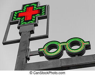 Pharmacy sign with blinking cross and glasses