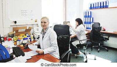 pharmacy worker talking by phone