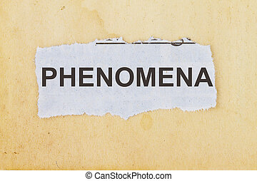 PHENOMENA  newspaper cutout in an old paper background.
