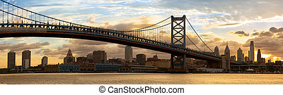 Philadelphia skyline panorama and Ben Franklin Bridge at...