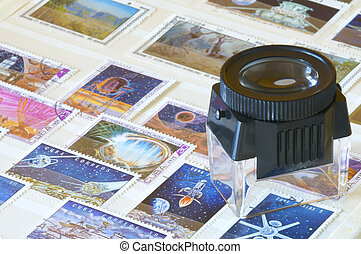 postage stamps and magnifying glass