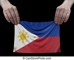 Philippine flag in hands