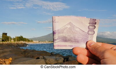 Philippine money. A Filipino monetary note in one hundred...