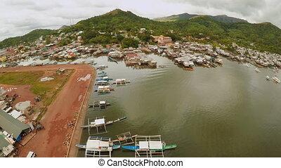 Philippine slums on the beach. Poor area of the city. Coron. Palawan. Philippines.