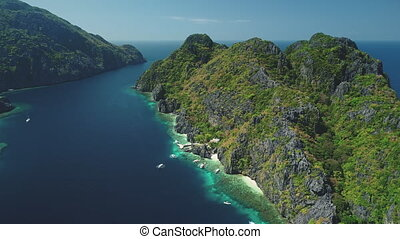 Philippines Hill Highland Islands at ocean gulf aerial view. Relax seascape with water transport of El Nido Islets, Palawan, Philippines, Asia. Cinematic summer tourism in soft light shot