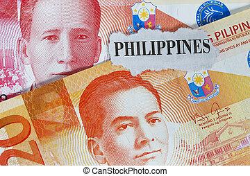 A partial close-up of a Philippine twenty peso bill