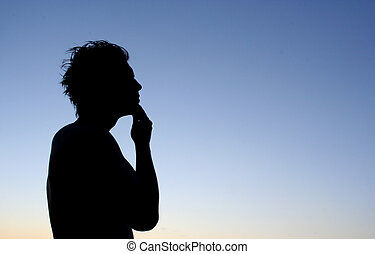 Silhouette of a thinking man