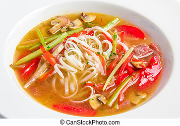Pho bo, Vietnamese soup with rice noodles, beef and...