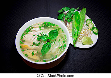 Pho ga or Vietnamese rice noodle soup with sliced chicken