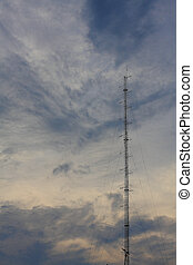 Phone antenna tower of the base phone station on sky