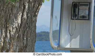 Phone Boot near Sea - Public phone booth near the sea.