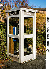 phone booth - a white french phone booth in a rural...