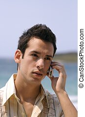 phone call - a young man talking to someone on a mobile...