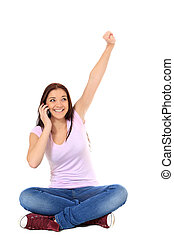 Phone call - Attractive teenage girl cheering during phone...