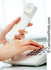 Phone call - Close-up of receptionist making a phone call
