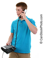 Phone Call - Cute 16 year old teen boy with telephone.