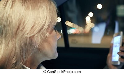 Phone Call - Extreme close up of woman seated in car making...