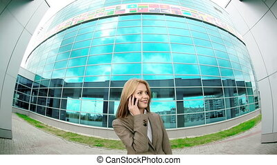 Phone Call - Fish eye camera shot of business woman talking...