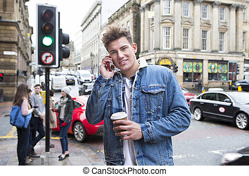 Phone call in the city - Portrait of a young man on the...