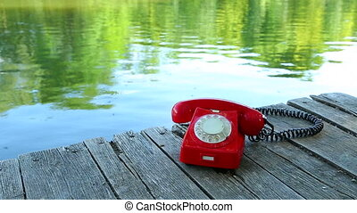 Phone Call - Old telephone ringing by the lakeside