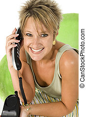 Phone Call - Happy woman on house phone.