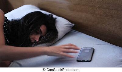 Phone call wake woman up - Shot of Phone call wake woman up