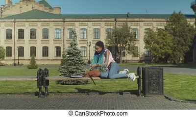 Phone call waking up student sleeping on bench