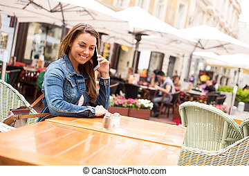 phone call - young woman talking on the phone at a ...