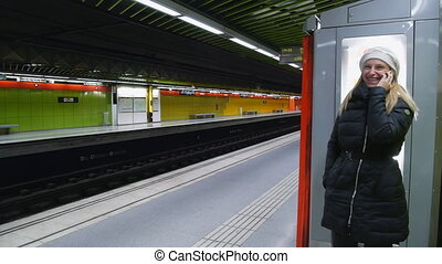 phone calling in the subway - beautiful woman talking on...